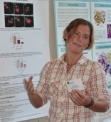 Michelle McNamara, a fourth year student in UVM's Neuroscience Graduate Program presents her work in a scientific poster at the 2013 College of Medicine Graduate Student Research Day.